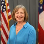 Sally Harrell Senate headshot with American flag